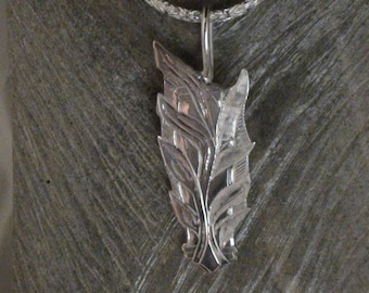 Hand engraved sterling silver pendant with 20 inch byzantine chain
