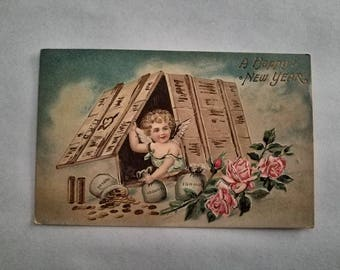 """Antique """"A Happy New Year"""" Postcard Made in Germany"""