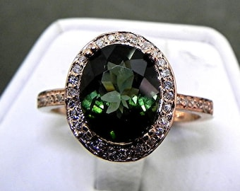 AAA Green Tourmaline   10x8mm  2.62 Carats   in a 14k ROSE gold ring with diamonds (.32ct) Ring 1138 MMMM