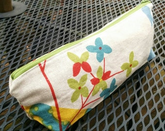 Pouch made with upholstery fabric remnants in blue, green, red and yellow, lined in blue