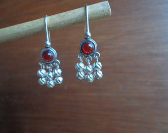 Carnelian earrings with twisted silver beads.