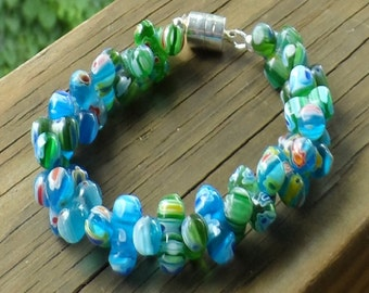 Women's  'bubble' bracelet with Millefiore beads in blues and greens with magnetic clasp