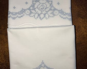 Unusual vintage blue and white cross stitched pillowcases
