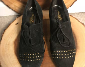 Black suede shoes with laces and gold studs