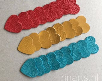 Leather hearts 3.5x3.5 cm  / 1.4 x 1.4 inch for your DIY projects. A set is 25 pieces, hearts in turquoise, red and yellow