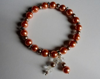 Peach and mink coloured stretch bracelet. Stretch bracelet with dangling bead charms. Beaded bracelet. Gift bracelet.