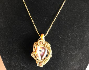 Glass Eye with Gold Tone Wire Wrap, Hangs Vertical!