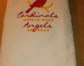 Cardinals appear when Angels are near hand towl