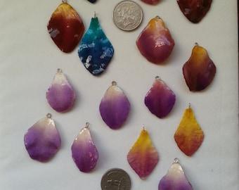 resin preserved orchid petal pendants