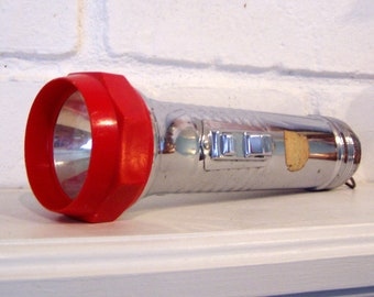 Old Chrome and Red Plastic Flashlight, works!, with ring on end, paper tag, mid century
