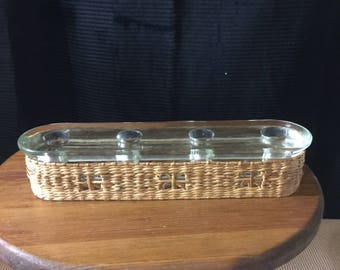 vintage basket and glass candlestick holder. Thick heavy glass embellished in a basket weave wrap.  Holds upto four (4) candles.