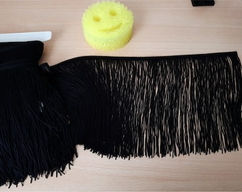 Galon with long black fringes of polyester