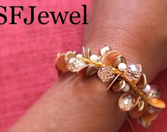 Summer sunset bracelet. Twisted wire with white agate beads, rhinestones and crystals.