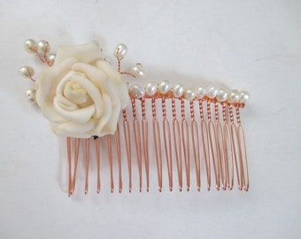 A rose gold plated haircomb with white freshwater cultured pearls and a white silk flower