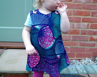 Girls dress in shell print fabric