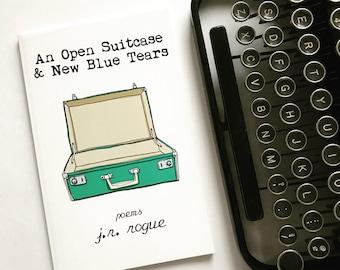 An Open Suitcase & New Blue Tears