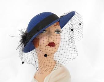 Woman's blue hat, vintage tilt with black feathers, netting