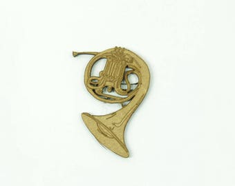 Decorative musical instrument of the brass family: the French Horn