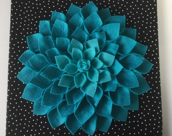 Turquoise blue Dahlia in a black and white polka dot background!