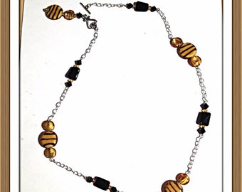 Handmade MWL gold and black striped beads and gold venetian glass  make this necklace. 0116