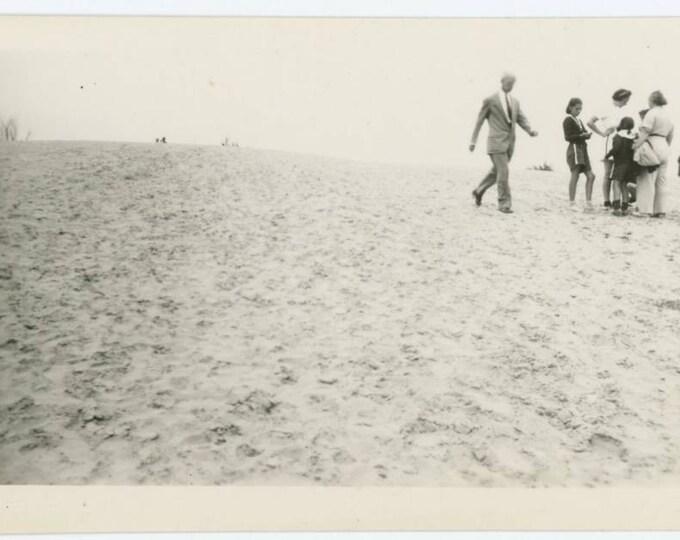 Vintage Snapshot Photo: Figures on Sandy Slope, 1940s (612526)