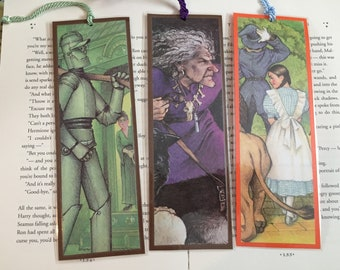 The Wizard of Oz bookmarks made from recycling the Dover Illustrated Classic book featuring The Wicked Witch of the West, Dorothy, Scarecrow