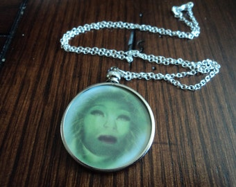 Madame Leota glass necklace