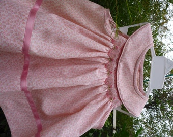 Pink smocked sundress with bullion roses & matching knickers.