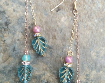 Blue Czech glass leaf dangle earrings with gold and rose gold filled chains and aqua and rose gold accent beads / bohemian style earrings