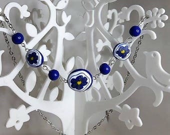 Indigo Flower necklace made of polymer clay.