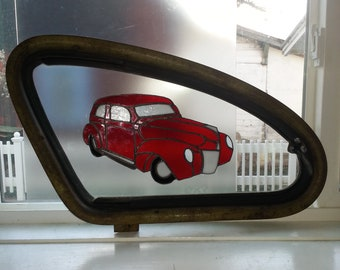Old red car on 1939 Ford window