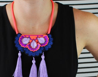 STATEMENT TASSEL NECKLACE in lilac, fluorescent orange, glittery blue and purple. Festival jewellery. U.V reactive bib necklace. Colourful