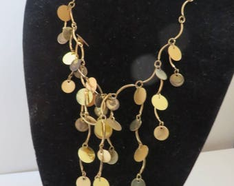 Gold tone & brass fluttery circle necklace