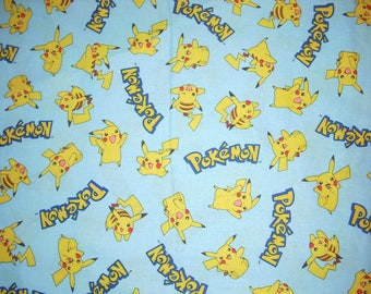 Pokemon Pikachu- on Blue  Cotton Fabric  40 inches long by 43 inches wide