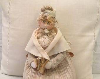 Handmade cloth doll.