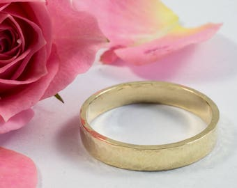 Gold Wedding Bands: A hers and hers set of 18k yellow gold textured wedding ring bands