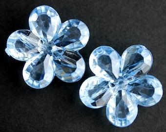 Two (2) Sky Blue Flower Buttons. Light Blue Buttons. Clear Buttons. Clear Acrylic Buttons. Plastic Buttons. 27mm