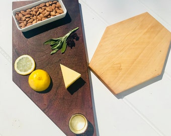 Mid century modern,Mahogany and maple pair of cutting boards in geometric shapes with (1) gold mercury glass votives