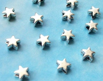 100 very tiny star beads, smooth/plain, shiny silver tone, 5mm