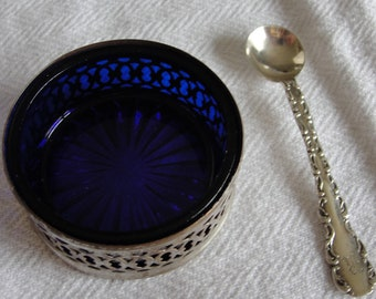 Vintage colbalt blue salt cellar with sterling silver ring and spoon.