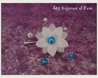 PIN back behind turquoise and white silk flower