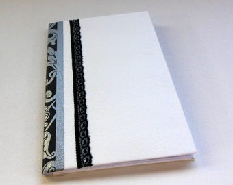 BOOK has tiles in baroque style and its matching pencil