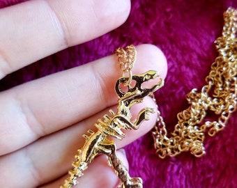 Gold T-rex skeleton necklace