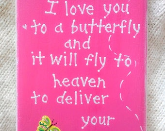 """Butterfly wall art plaque with saying, """"Whisper I love you to a butterfly and it will fly to heaven to deliver your message."""""""
