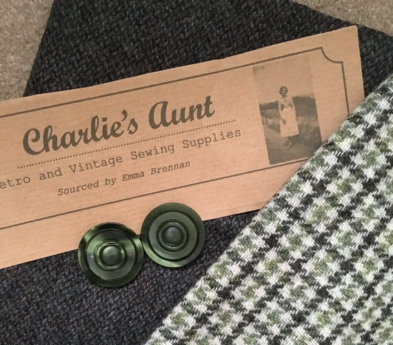"""Two pieces of British wool tweed in tones of green, one plainer in 18"""" x 60"""" and one in  houndstooth 20"""" x 30"""" plus 2 vintage buttons"""