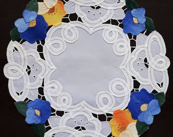 Vintage round lace doily with flower applique