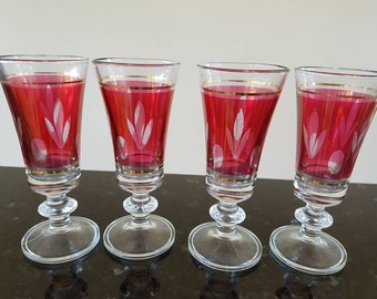 Four beautiful red cranberry patterned italian glasses
