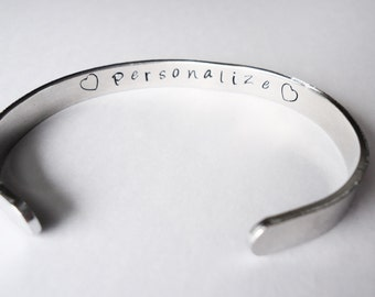 Secret message inside cuff- Hand stamped cuff- You choose the words and or the designs stamped on it - made just for you - custom bracelet