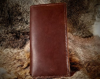A Long, Roper Style Wallet Made from All Full Grain Leather. 6 Pockets and 2 inside pockets along with a billfold, this wallet HOLDS A LOT