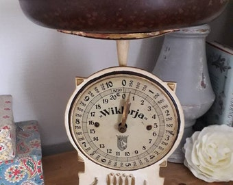 Vintage European cast iron scale in cream and gold with moulded tray.